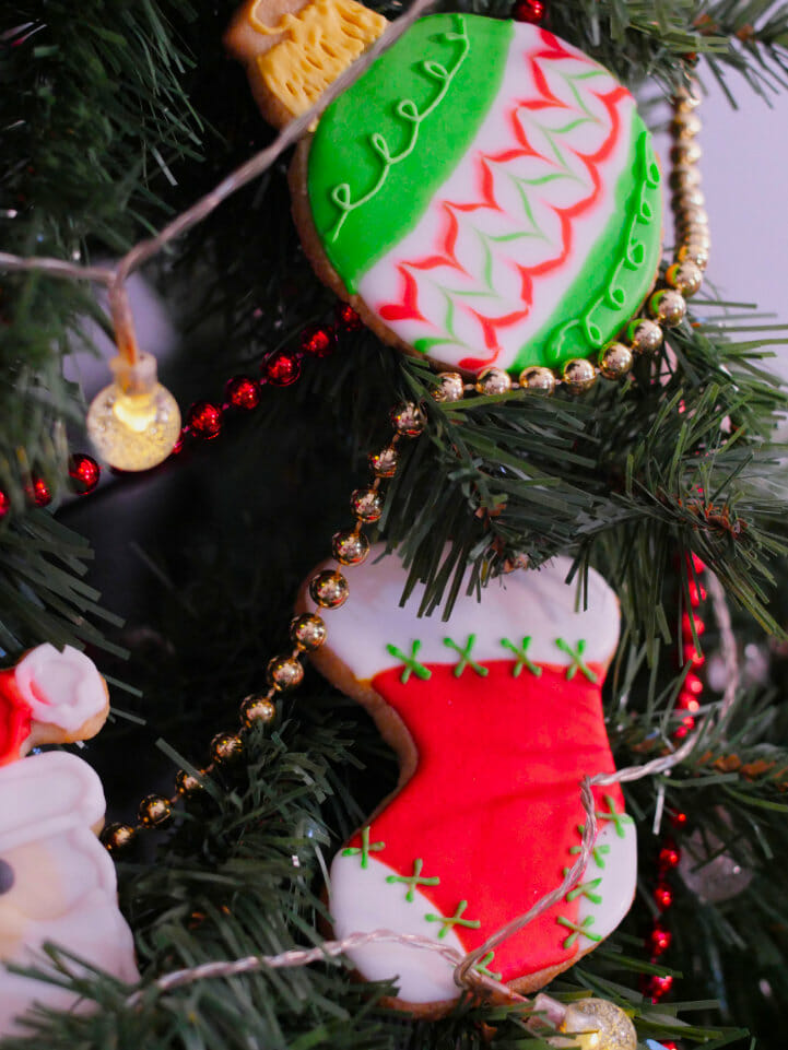 A Stocking cookie and an Ornament cookie in a Christmas tree